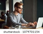 focused millennial redhead man... | Shutterstock . vector #1079701154