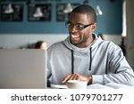 smiling millennial african... | Shutterstock . vector #1079701277