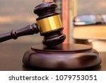 judge gavel beside pile of... | Shutterstock . vector #1079753051
