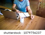 writer writing information in... | Shutterstock . vector #1079756237