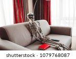 skeleton sitting between book... | Shutterstock . vector #1079768087