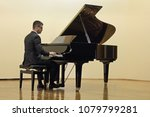 pianist playing the piano | Shutterstock . vector #1079799281