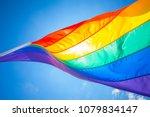 rainbow flag on a gay beach in... | Shutterstock . vector #1079834147