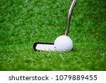 golf putter and white golf ball ... | Shutterstock . vector #1079889455