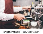 man barista using coffee... | Shutterstock . vector #1079893334