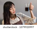 asian young woman drinks coffee ... | Shutterstock . vector #1079920997