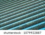 windows of business building | Shutterstock . vector #1079922887