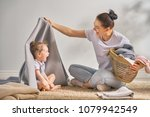 beautiful young woman and child ... | Shutterstock . vector #1079942549