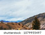 behind mammoth hot springs view ... | Shutterstock . vector #1079955497