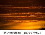 orange cloud bands | Shutterstock . vector #1079979527