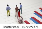 Small photo of Bar charts and miniature people. Theconceptofmissingpromotionsforwomenatwork.