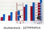 Small photo of Bar charts and miniature people. The concept of gender discrimination in employment and wages.