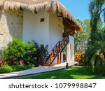 a house under palm leaves roof... | Shutterstock . vector #1079998847
