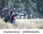 a young mother with her... | Shutterstock . vector #1080036281