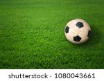 old soccer ball on green grass | Shutterstock . vector #1080043661
