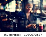 woman waiting at a cafe | Shutterstock . vector #1080073637
