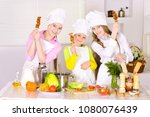 happy cute girls  cooking... | Shutterstock . vector #1080076439