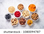 nuts and dried fruits... | Shutterstock . vector #1080094787