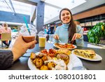 couple sit in mall cafe and... | Shutterstock . vector #1080101801
