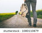 traveler holding backpack and... | Shutterstock . vector #1080110879