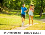 young couple running in the... | Shutterstock . vector #1080116687