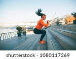 fitness woman jumping outdoor... | Shutterstock . vector #1080117269
