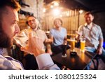 handsome man drinking a glass...   Shutterstock . vector #1080125324
