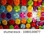 colored umbrellas hanging... | Shutterstock . vector #1080130877