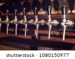 beer tap row. beer taps in bar. ... | Shutterstock . vector #1080150977