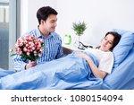 caring loving husband visiting... | Shutterstock . vector #1080154094