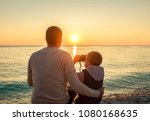 father and son sitting on the... | Shutterstock . vector #1080168635