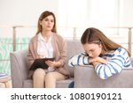 young female psychologist... | Shutterstock . vector #1080190121