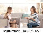 young female psychologist... | Shutterstock . vector #1080190127