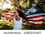 young woman enjoying in park... | Shutterstock . vector #1080231407