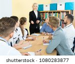 group of attentive students and ... | Shutterstock . vector #1080283877