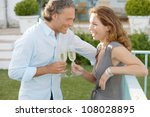 mature couple toasting with... | Shutterstock . vector #108028895