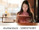 woman looking on her tablet for ... | Shutterstock . vector #1080376385