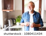 happy senior man holding a cup... | Shutterstock . vector #1080411434