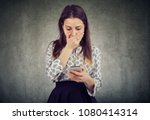 young woman covering mouth in... | Shutterstock . vector #1080414314