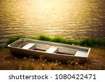 boat on a lake coast in sunset   Shutterstock . vector #1080422471