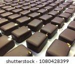 Small photo of Dark chocolate praline in square shape