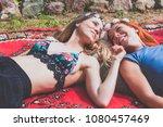 two hippie girlfriends enjoying ... | Shutterstock . vector #1080457469