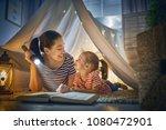 family bedtime. mom and child... | Shutterstock . vector #1080472901