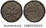 Small photo of Russia Russian copper coin polushka (quarter kopek) 1734, ruler Empress Anna Ioannovna, crowned eagle with two heads, denomination within shield surrounded by floral composition
