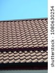 a fragment of a roof from a... | Shutterstock . vector #1080630254