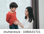 mother dressing up a son for... | Shutterstock . vector #1080631721