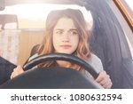 nervous female driver sits at... | Shutterstock . vector #1080632594
