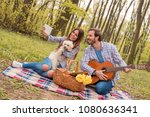 lovely young couple enjoying... | Shutterstock . vector #1080636341