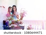 a young girl with a daughter is ... | Shutterstock . vector #1080644471