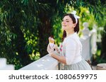 the saleswoman offers to buy... | Shutterstock . vector #1080659975